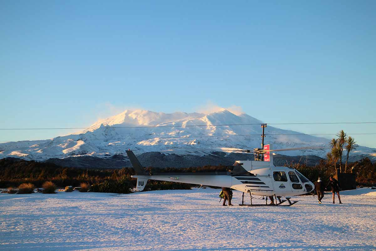 Helisika ZK-HIU on a snowy day at Discovery with Mt Ruapehu in the background