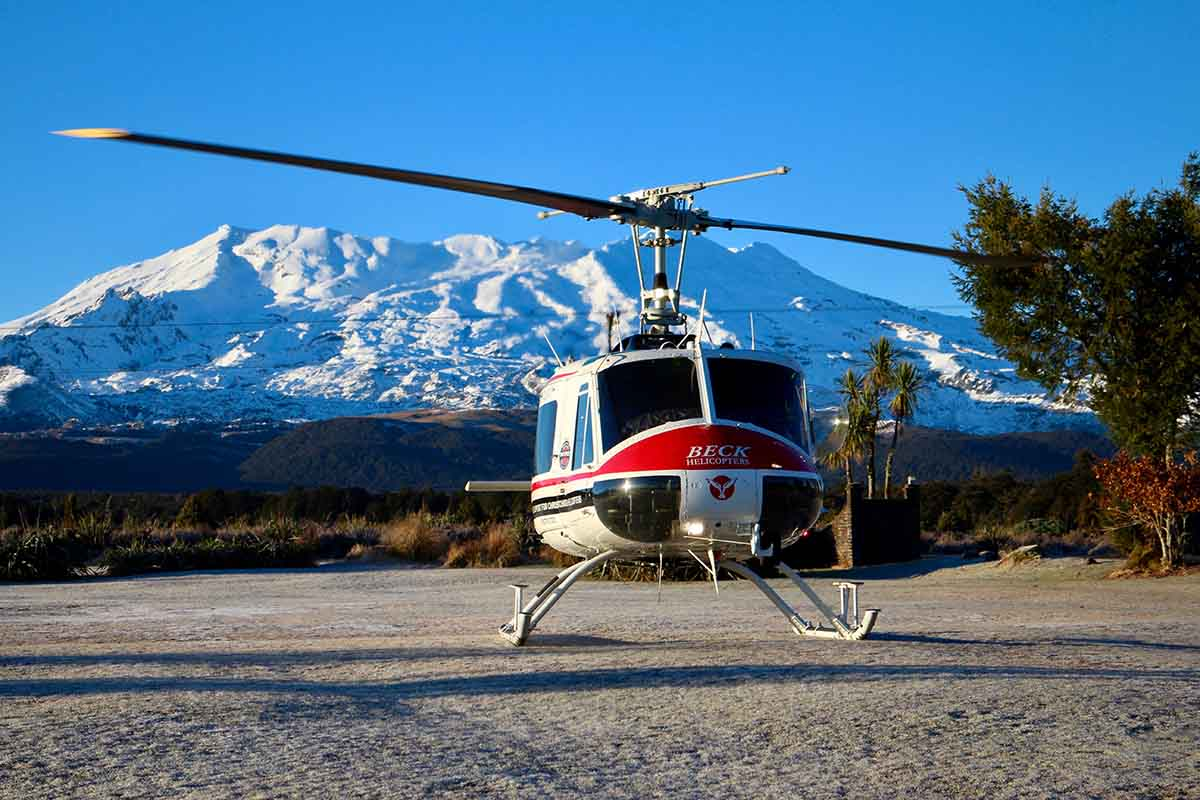 Beck Helicopters ZK-HHA at Discovery's helipad with Mt Ruapehu