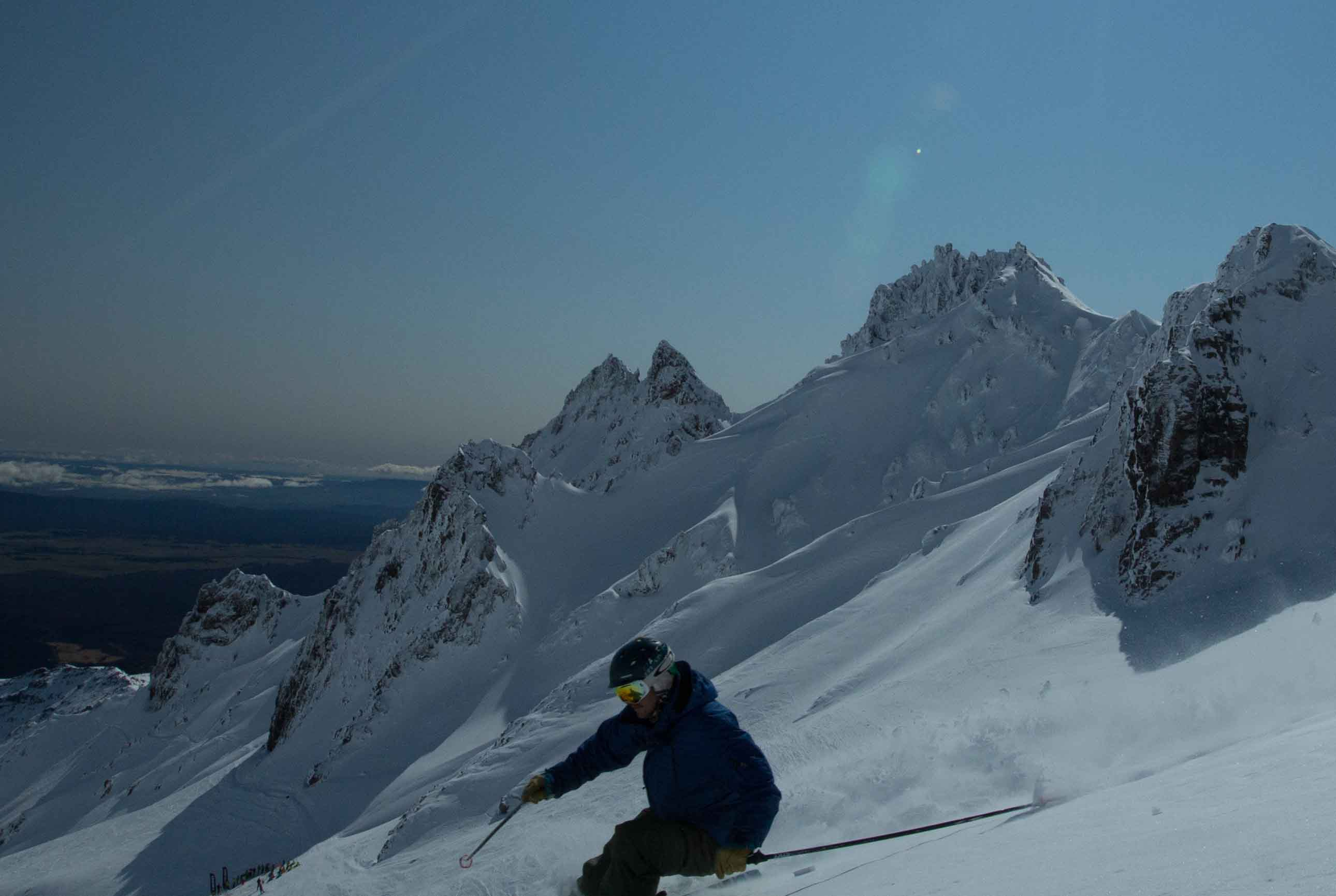 Skier with the Pinnacles of Mt Ruapehu in the background at Whakapapa