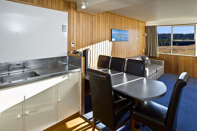 Interior of a Discovery Lodge motel one bedroom at Tongariro National Park with views of alpine meadows