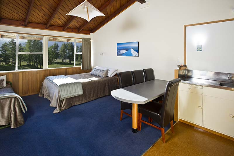 Interior of a Discovery Lodge motel studio at Tongariro National Park with views of alpine meadows