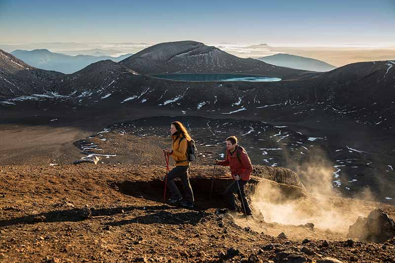 A couple enjoying peace and quite on the Tongariro Crossing with the Blue Lake in the background
