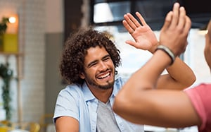 Happy person giving high five