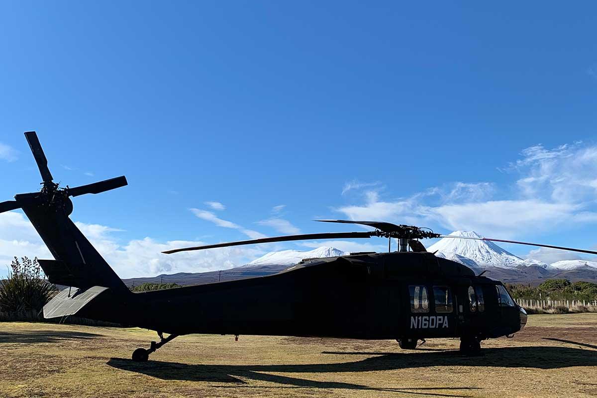 Kahu Blackhawk with snow-capped Mt Ngauruhoe at Discovery helipad Tongariro
