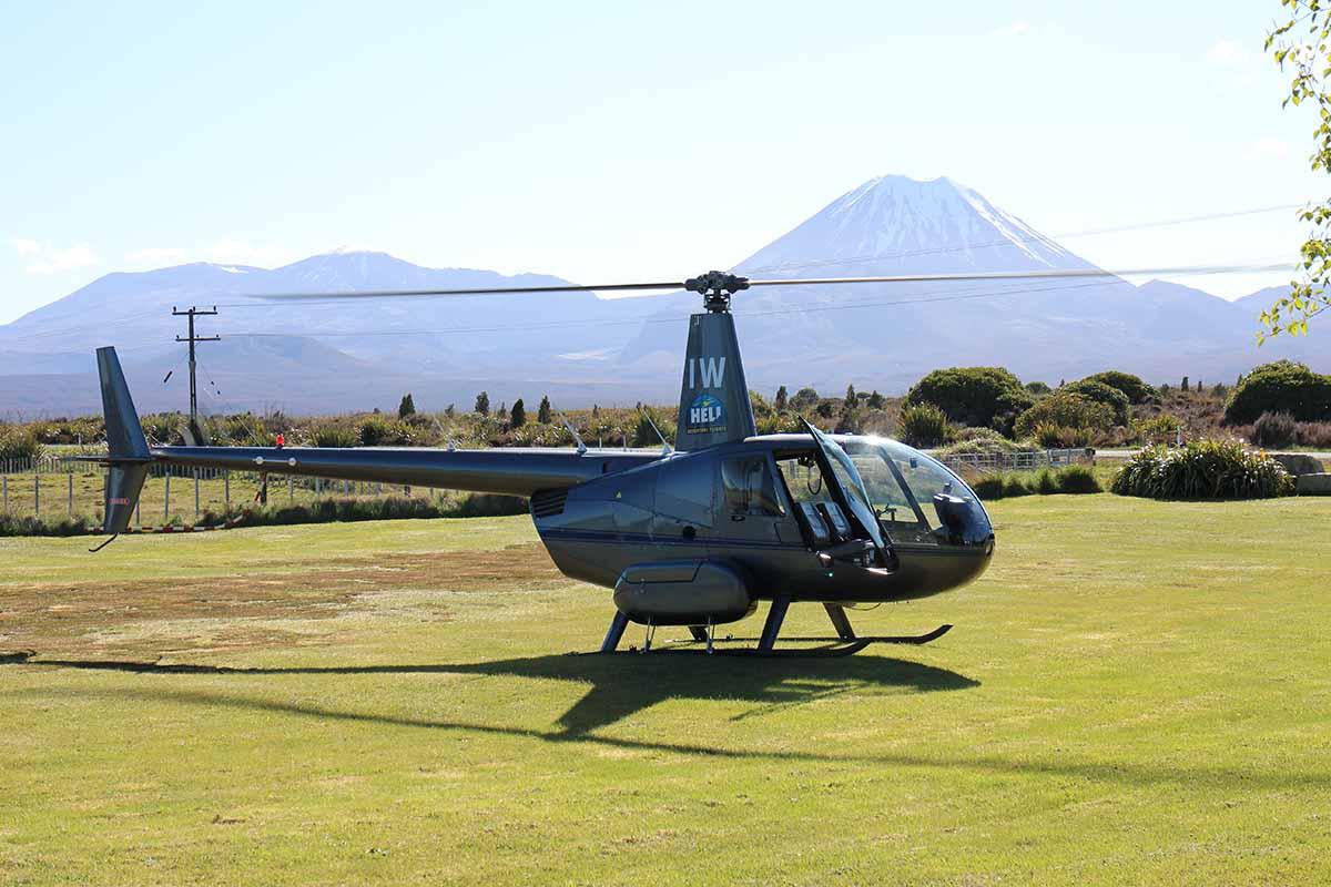 Helisika ZK-HIW at Discovery Helipad with Tongariro & Ngauruhoe in the background