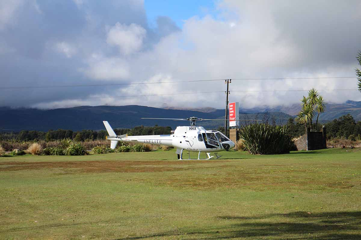 Inflite ZK-HHX at Discovery Helipad with foothills of Mt Ruapehu