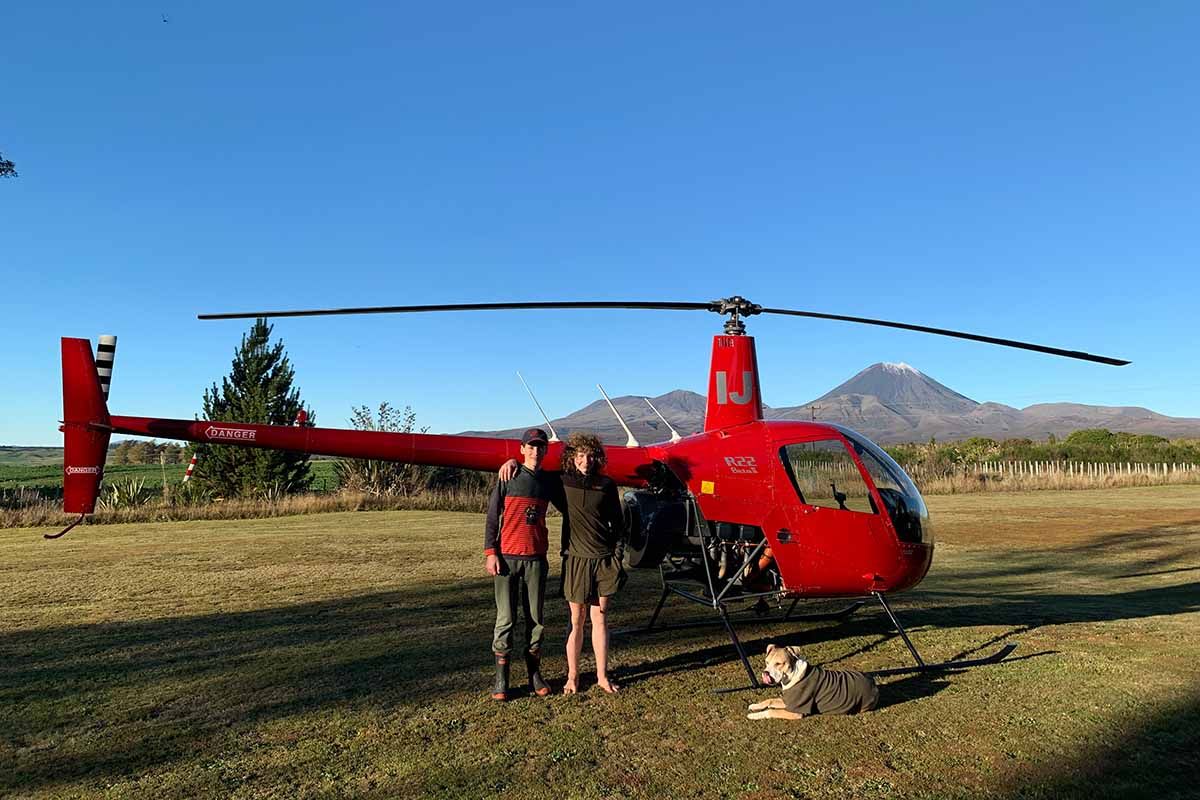 Steve's ZK-HIJ with Abel & Cody with Mt Ngauruhoe in the background