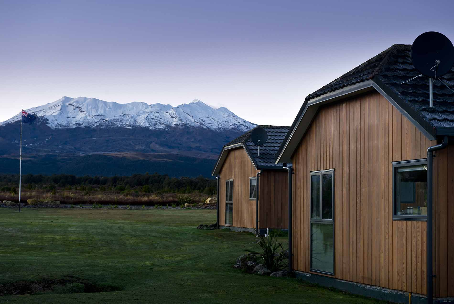 Two chalets with a close up view of Mt Ruapehu and the Tongariro National Park from Discovery Lodge