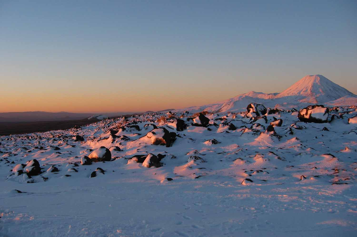 Mt Ngauruhoe on the Tongariro Alpine Crossing during winter with snow all around