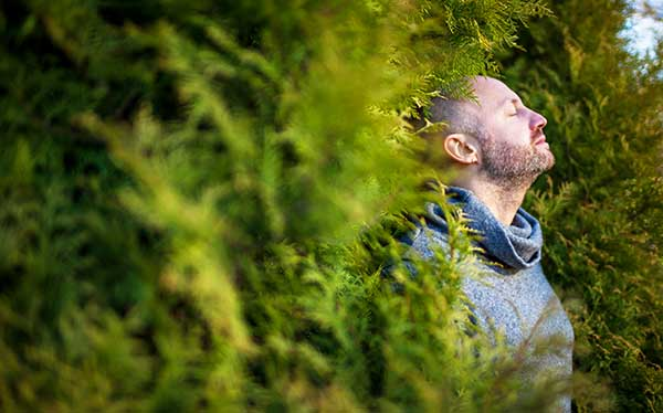 Man soaking up peace from nature