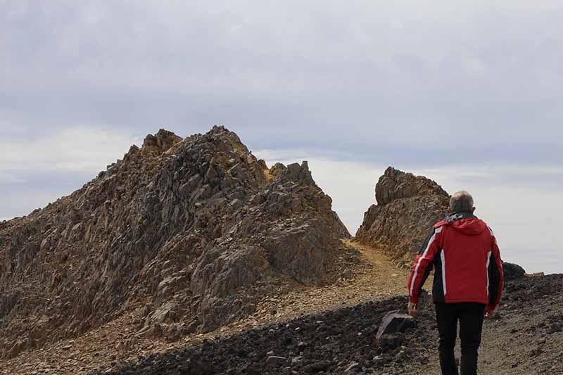 A hiker at the Skyline Ridge at Whakapapa Mt Ruapehu